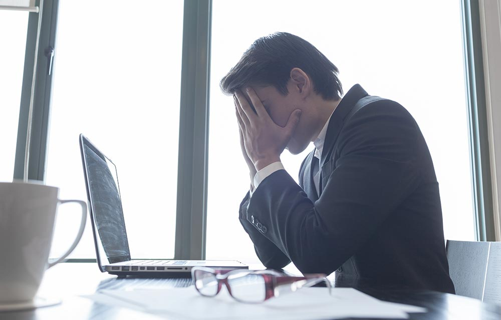 stressed headteacher before coaching in schools